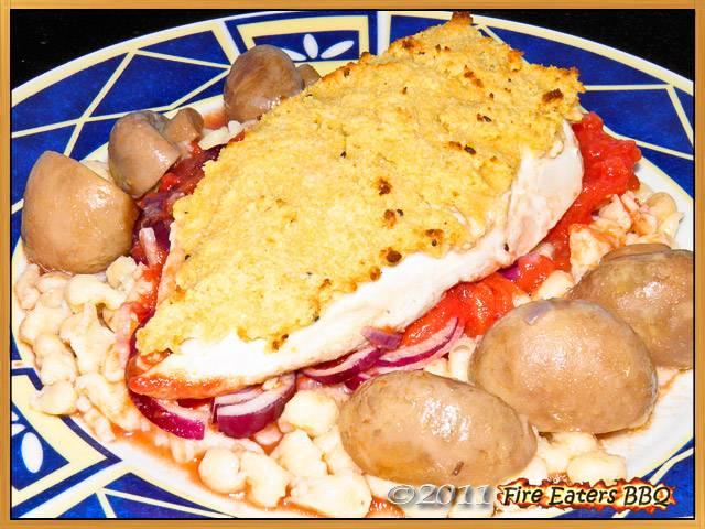 Hähnchenschnitzel mit Senfkruste in Tomatensauce